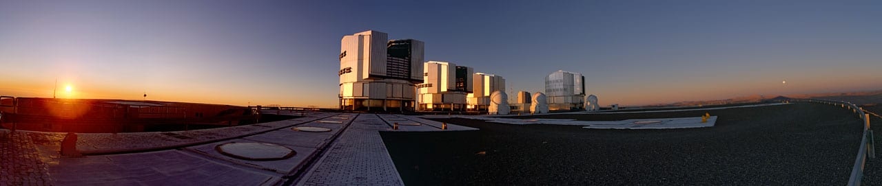 Magnificent sunset panorama on the telescopes of ESO's Very Large Telescope (VLT) observatory on Cerro Paranal, marking the beginning of the frantic activity of the astronomers observing the night sky.